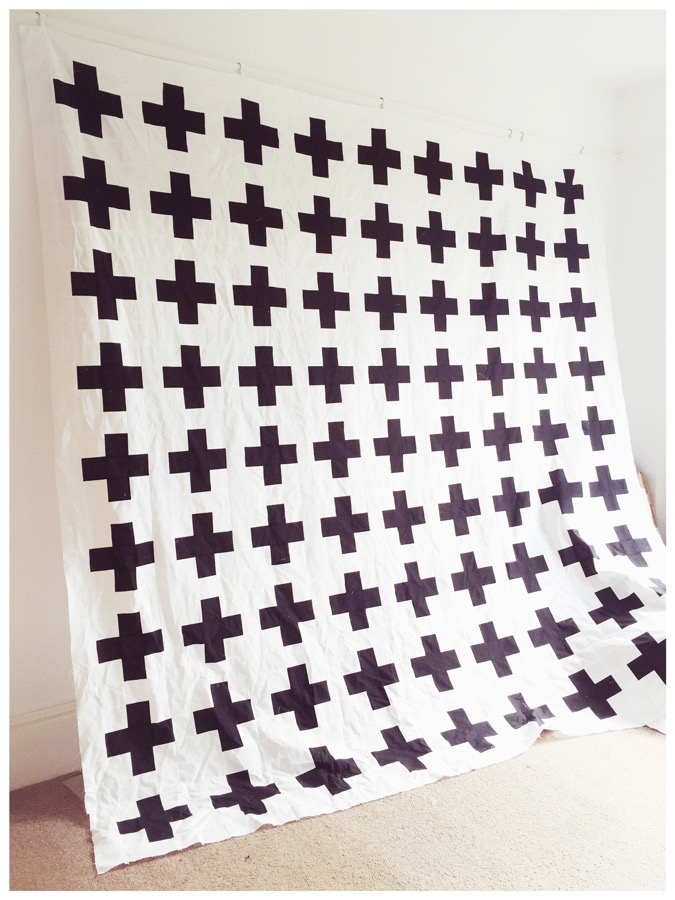 Black and white contemporary quilt top - plusses.