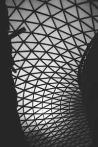Glass roofs: Black and white abstract photograph of the glass roof at the British Museum.